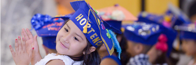 kindergarten student in graduation cap